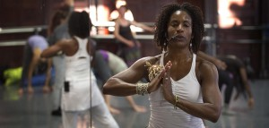 Afro Flow Yoga instructor Leslie Salmon Jones leads the group in a yoga session at the Dance Complex in Cambridge, Mass. (Robin Lubbock/WBUR)